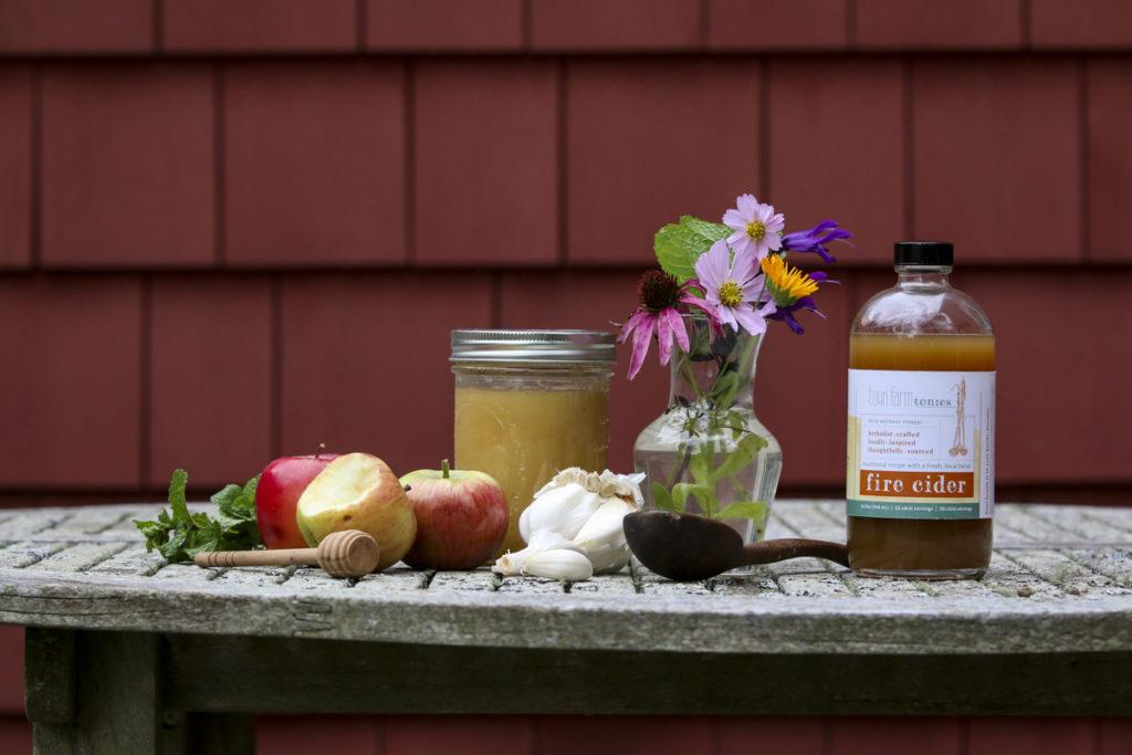 Fire Cider tonic with ingredients: garlic, onion, organic apple cider vinegar, Massachusetts wildflower honey